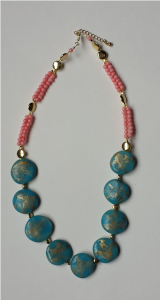 Jewelry with blue stones made of clay.